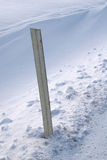 Road marker. A road marker surrounded by fresh snow Royalty Free Stock Photo