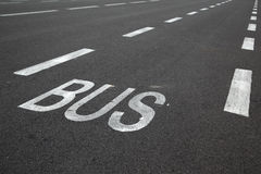 Road marking. Over black asphalt of carriageway Stock Images