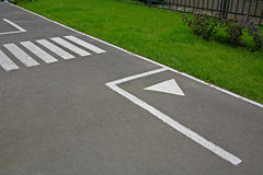 Road marking. The image area of the roadway with traffic markup Stock Image
