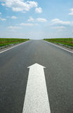 Road marking arrow. White arrow at detailed texture asphalt royalty free stock images