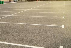 Road marking on an empty asphalt Parking lot, a copy of the space, mockup. Location, line, street, automobile, background, driving, paint, pattern, traffic royalty free stock image