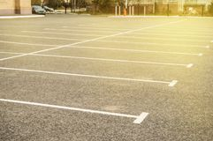 Road marking on an empty asphalt Parking lot, a copy of the space, mockup. Location line street automobile background driving paint pattern traffic royalty free stock images