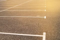 Road marking on an empty asphalt Parking lot, a copy of the space, mockup. Location line street automobile background driving paint pattern traffic royalty free stock photos