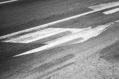Road marking with tire tracks on asphalt Stock Photo
