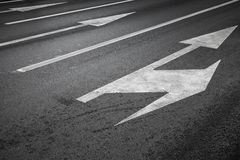 Road marking with white lines and arrows Stock Photography