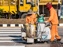 Road Marking Workers at Work. Royalty Free Stock Image