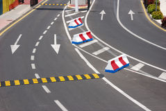 Road markings. Four lanes and striped barriers Stock Photo