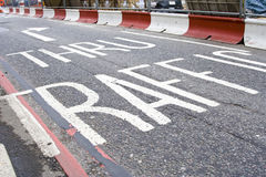 Road markings. UK 'Thru Traffic' road markings Royalty Free Stock Images
