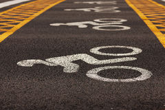 Road markings applied to asphalt. Pavement near the traffic lights Royalty Free Stock Images