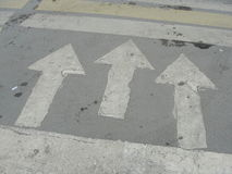 Road markings. arrows showing the direction of movement at the intersection crosswalk. Royalty Free Stock Photography
