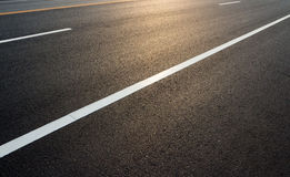 Road markings on asphalt. Empty space for text messages Stock Image
