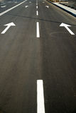 Road markings on the asphalt road in the city Stock Image
