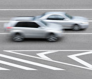 Road markings and cars Stock Images