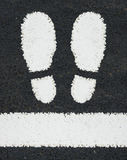 Road Markings Feet. Symbol Of Two Feet Painted As A Road Marking Royalty Free Stock Photo