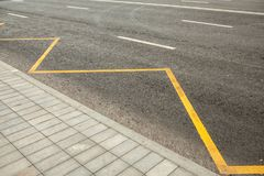 Road markings indicating no stopping or parking. Bus station Stock Photos