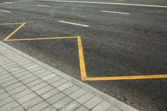 Road markings indicating no stopping or parking. Bus station Stock Photography