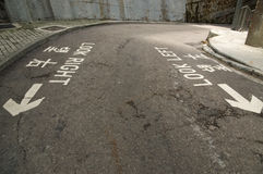 Road markings on a street in Hong Kong. Showing look left and look right Royalty Free Stock Photography
