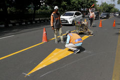 Road markings. Workers were making road markings in the city of Solo, Central Java, Indonesia Stock Photography