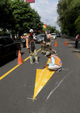 Road markings. Workers were making road markings in the city of Solo, Central Java, Indonesia Royalty Free Stock Photos