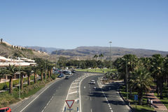 Road in Maspalomas. Maspaloms, Gran Canaria, Spain: View of a road in Maspaloms with the hills of Gran Canaria on the background. Foto is taken on March 17, 2015 royalty free stock images