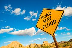 Road May Flood Warning Sign royalty free stock photos
