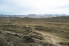 Road among among meadow. The country road on Olkhon iland, Baikal lake Royalty Free Stock Photography
