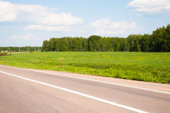 Road and the meadows Stock Photography
