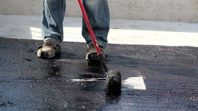 Road men manually applying asphalt on the highway stock video