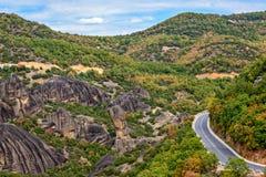 Road between Meteora rocks Royalty Free Stock Image