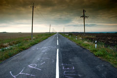 Road in middle of rural area. In the evening Stock Images