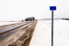 Road mileage sign. In winter next to the road Royalty Free Stock Photo