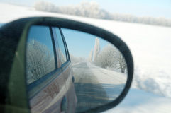 Road in mirror. Road reflected in rear-view mirror Royalty Free Stock Photography