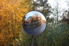 Road mirrow. Reflection in the mirriow, autumn Royalty Free Stock Photos