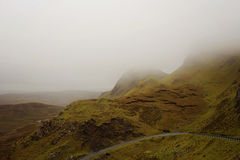 Road Through Misty Mountain Range in Scotland Royalty Free Stock Photos