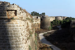 Road and city wall. Road in moat and city wall in Famagusta, North Cyprus Royalty Free Stock Images