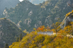 Road and montains. A road across mountain at afternoon in fall stock photos
