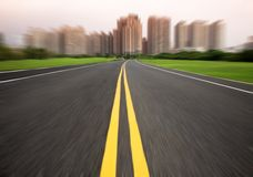 Road in motion blur. The road to city in motion blur Stock Images
