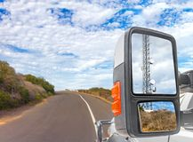 Truck side rear view mirror with cellphone communication tower. stock images