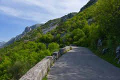 The road in the mouintains. The road in the mountains, walled with stone blocks in Montenegro Royalty Free Stock Photo