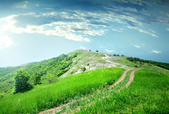 Road in mountain and blue sky Royalty Free Stock Photography