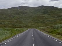 Road in mountain landscape in north Sweden royalty free stock photos