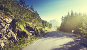 Road in mountain, Lofoten islands, Norway Stock Photo
