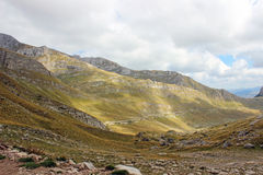 The road between the mountain massif in Montenegro. In the fall Stock Photography