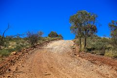 Road in mountain off road, gravel uphill Australia Royalty Free Stock Photo