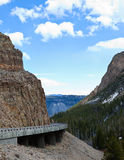 Road Through a Mountain Pass in Yellowstone Royalty Free Stock Photo