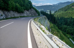 Road between mountain. Perfect road in the Austrian Alps Stock Photography