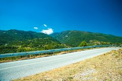 Road in mountain range at Olympos Mountains Stock Photos