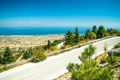Road in mountain range at Olympos Mountains Royalty Free Stock Photography