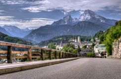 Road and mountain resort. Berchtesgaden landscape and Watzmann mountain, Bavarian Alps, Germany Royalty Free Stock Images