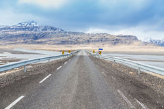 Road through mountain snow covered countryside Royalty Free Stock Photo